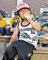A young resident of the Biko-en Children's Care House enjoys a hot dog during a community relations event sponsored by Naval Air Facility (NAF) Misawa, Japan, June 28, 2014 140628-N-ZI955-319.jpg
