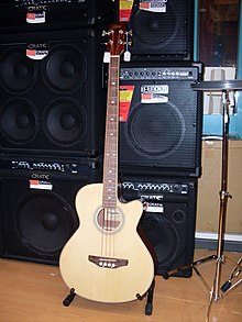 A display of bass amplifiers and bass speaker cabinets at a music store.