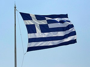Greek flag over the eastern corner of the Acro...