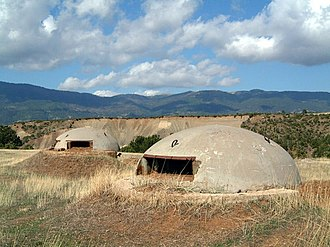 People's Socialist Republic of Albania - Bunkers in Albania built during Hoxha's rule to avert the possibility of external invasions. By 1983 approximately 173,371 concrete bunkers were scattered throughout the country.