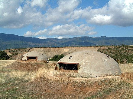 Bunkers in Albania built during Hoxha's rule to avert the possibility of external invasions. By 1983 approximately 173,371 concrete bunkers were scattered throughout the country. Albania bunkers.jpg
