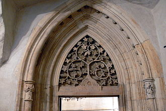 Czech Gothic architecture - Portal of the Old New Synagogue in Prague using vine-leaf motifs, after 1270.