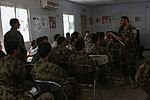 An Afghan National Army (ANA) sergeant first class and medic instructor, standing right, assigned to the 201st Corps, asks an Afghan soldier a question during an ANA-led medic training course at Forward 130617-A-XM609-027.jpg