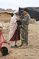 An Afghan National Army commando, right, with the 4th Special Operations Kandak speaks with a village elder during a reconnaissance patrol in the Shah Wali Kot district, Kandahar province, Afghanistan, Feb. 18 140218-A-YF193-056.jpg
