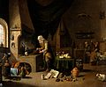 An alchemist in his laboratory. Oil painting by a follower o Wellcome V0017688.jpg