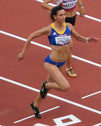 Romania at the 2012 Summer Olympics - Andreea Ogrăzeanu runs the evening heat in women's 100 m.