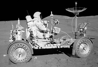 Lunar Roving Vehicle - Apollo 15 – Commander David Scott drives the Rover near the LM.