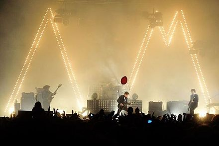 Arctic Monkeys performing at the InMusic Festival on 25 June 2013. The concert was a part of the AM Tour.