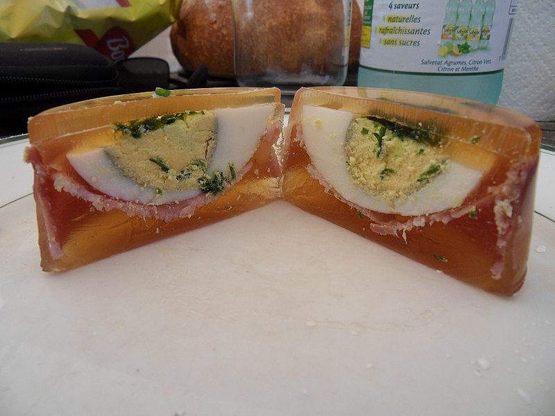 Picture of boiled eggs, halved, in aspic