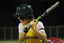 woman holding softball bat