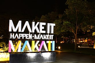 "Makati Central Business District - Ayala Triangle with the city's new slogan - ""Make it Happen, Make it Makati."""