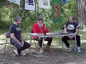 "Ásatrú Alliance - Michael ""Valgard"" Murray (center) with Stephen McNallen (left) and Eric ""Hnikar"" Wood (at the 2000 IAOA Althing)"