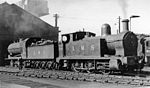 Bank Hall Locomotive Depot in 1948: two ex-Lancashire & Yorkshire engines View SW, outside the smaller through Shed: ex-L 1F 0-6-0T No. 11535, fitted with dumb buffers and swinging spark-arrestor for working in the Docks; behind it is Class 30 6F 0-8-0 No. 12782. (Beyond can be glimpsed an 8F 2-8-0 with the unusual combination of 'M' as well as the BR initial '4' added to its number).