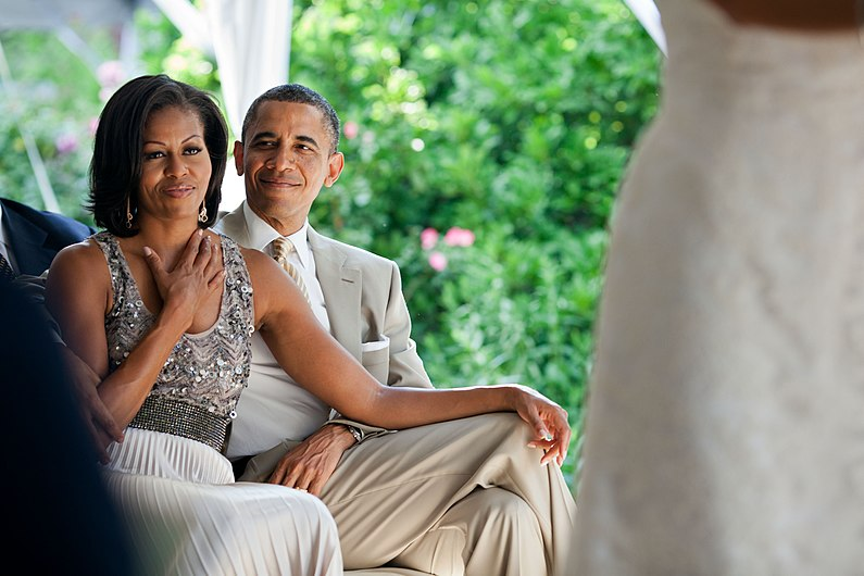 Barack and Michelle Obama watching a wedding.jpg