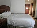 Bed in hotel room 6.jpg