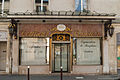 Boutique in front of the church, Versailles August 2013.jpg