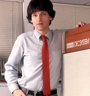 Brian Moriarty - Brian Moriarty stands beside Infocom's DECSYSTEM-20 mainframe (1984)
