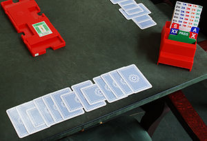 Board (bridge) - The orientation of the cards indicates that the partnership has lost the third, seventh and ninth tricks and won the other ten.