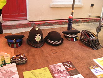 Police community support officer - Types of headgear used by Thames Valley Police. From left: male PCSO flat cap, male PC custodian helmet, female PC bowler hat, male PC flat cap, cycle helmet.