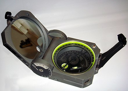 A standard Brunton Geo compass, still used commonly today by geographers, geologists and surveyors for field-based measurements Brunton.JPG