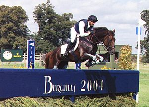 Burghley Horse Trials - A competitor in the 2004 Horse Trials shows good form over the first fence on the cross-country course.