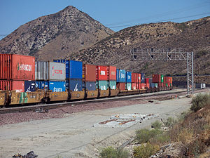 Double-stack rail transport - A BNSF double-stack train passing through Cajon Pass in California, with a mix of 20 and 40-foot containers