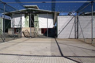 Camp Delta (Guantanamo Bay) - A Camp Delta recreation and exercise area at Guantanamo Bay. The detention block is shown with sunshades drawn on 3 December 2002.