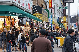Canal Street (Manhattan) - Stores and vendors dot Canal Street, hawking merchandise