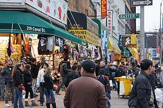 Canal Street (Manhattan) - Stores and vendors dot Canal Street, hawking merchandise