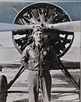 Capt. C.L Chennault, leader of The Flying Trapeze poses in front of a Boeing P-12E.jpg