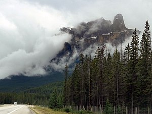 Castle Mountain - Castle Mountain's Eisenhower Tower rises from the mist above the Trans-Canada Highway.