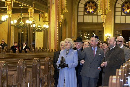 Camilla, Duchess of Cornwall, Prince Charles and Chief Rabbi Robert Frolich in the Dohany Street Synagogue, the largest synagogue in Europe Charles and Camilla in Dohany Street Synagogue.jpg