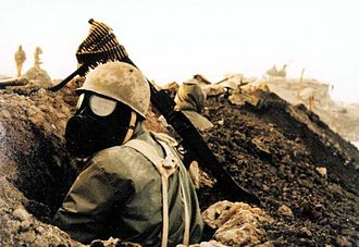 Iran and weapons of mass destruction - Iranian soldier with gas mask under chemical bombardment by Iraqi forces in the battlefield during the Iran–Iraq War.