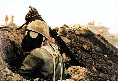 An Iranian soldier with gas mask during the Iran–Iraq War Chemical weapon1.jpg