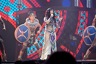 """Strong Enough (Cher song) - Cher performing """"Strong Enough"""" at her 2014 Dressed to Kill Tour during a gladiator-themed segment of the show."""