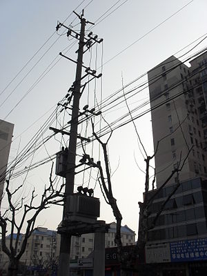 Utility pole - A joint-use utility pole in China.