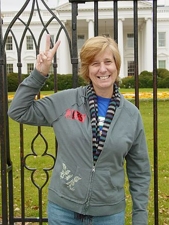 Cindy Sheehan - Sheehan gives the peace sign in front of the White House in 2006.