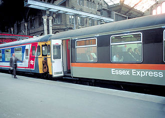 Network SouthEast - Two Class 309 (AM9) units; one in NSE livery, the other in Jaffa Cake livery