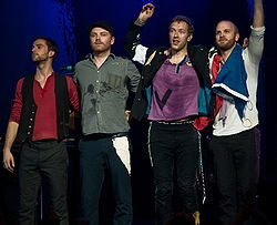 Guy Berryman, Jonny Buckland, Chris Martin, Will Champion (v.l.n.r., 2008)