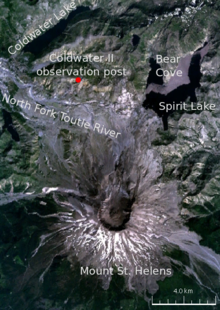 Satellite image of the area surrounding Mount St. Helens, labeled with various locations. The primary locations marked are: Mount St. Helens (in the center of the volcano there is a circular black crater); and to the north of the volcano the Coldwater II observation post, where Johnston was camped. The other locations marked are three lakes (Spirit Lake, Bear Cove, and Coldwater lake) and a river (North Fork Toutle River).