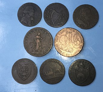 These penny (centre) and halfpenny tokens circulated during the coinage emergencies of the late 18th and early 19th century. Conder tokens.jpg