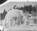 Crater of Lone Star Geyser. Arnald Hague on summit of cone. Yellowstone National Park. - NARA - 517624.tif
