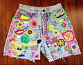 Customised cut-off denim shorts with peace symbols and slogans, American, 1990s.jpg
