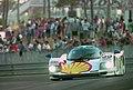 Dauer 962 LM - Hans-Joachim Stuck, Thierry Boutsen & Danny Sullivan exits the Esses at the 1994 Le Mans (31596777130).jpg