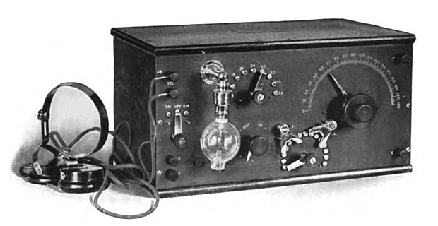De Forest's first commercial Audion receiver, the RJ6 which came out in 1914. The Audion tube was always mounted upside down, with its delicate filament loop hanging down, so it did not sag and touch the other electrodes in the tube. De Forest RJ6 Audion radio receiver.jpg