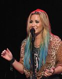 Demi Lovato smiling and singing closeup.JPG