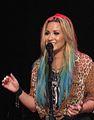 Demi Lovato smiling and singing closeup.JPG