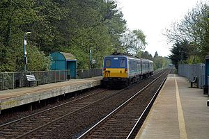 Derriaghy railway station - NIR Class 80 train departing Derriaghy in 2004