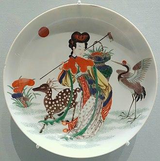 Magu (deity) - Porcelain dish with overglaze decoration depicting Magu, deity of longevity, Jingdezhen, Jiangxi province, Qing dynasty, c. 18th century, Asian Art Museum of San Francisco.