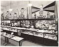 Display cases with assorted merchandise, Rhodes Brothers Department Store, Seattle, ca 1924 (MOHAI 7397).jpg